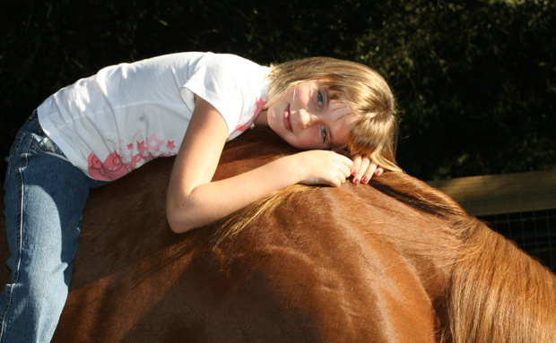 girl-laying-on-horse
